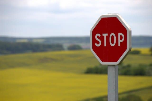 Example image of a road side traffic stop sign, for discussing text detection using OpenCV.