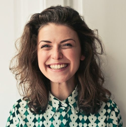 Example of the photo that can be tagged as: portrait, woman, smiling, brown hair, wavy hair