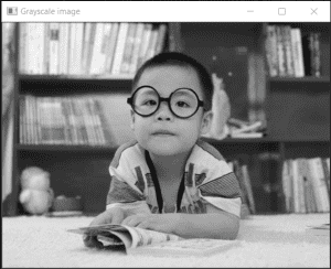 Boy with spectacles in grayscale