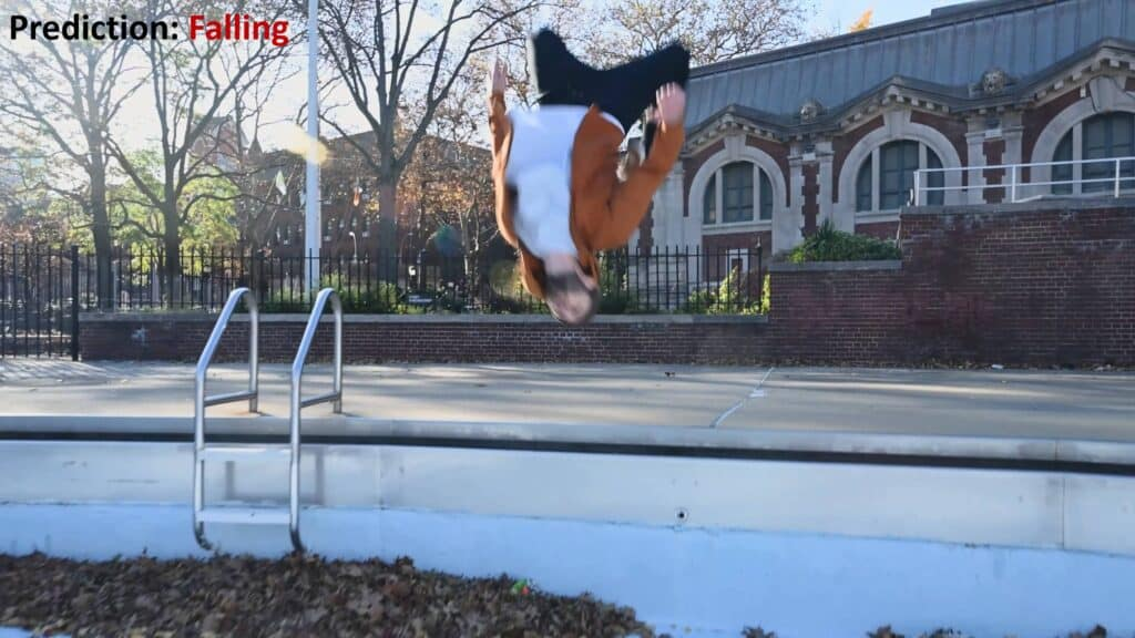 Random snapshot from the video of a person performing a backflip. If used as single input, the system may predict the action incorrectly as falling.